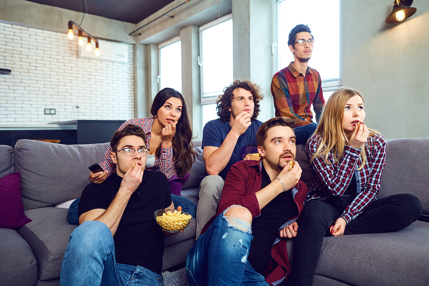 group of people watching TV