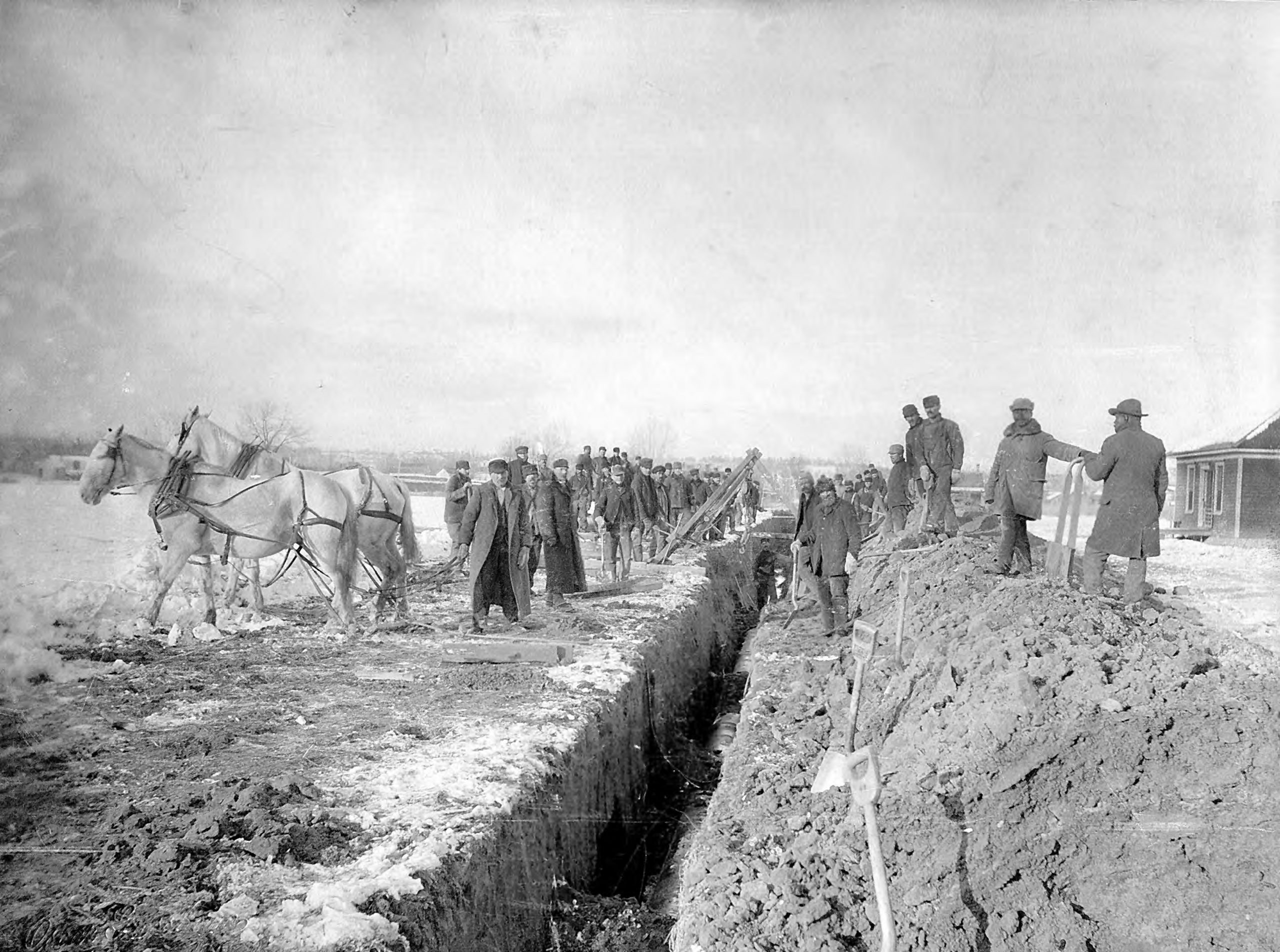 vintage photo of employees digging a water ditch