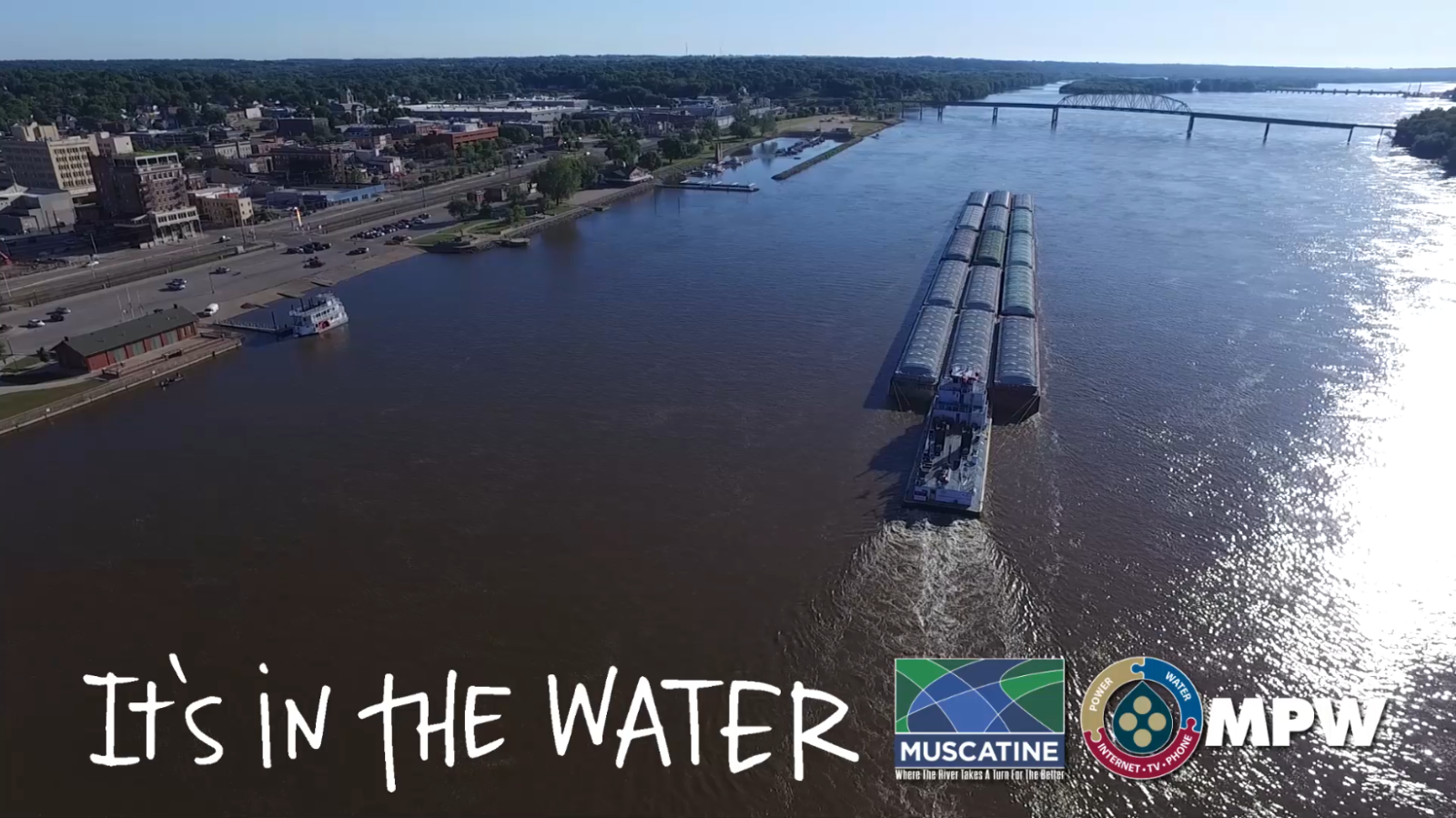 Barge on Mississippi River with Text on Image