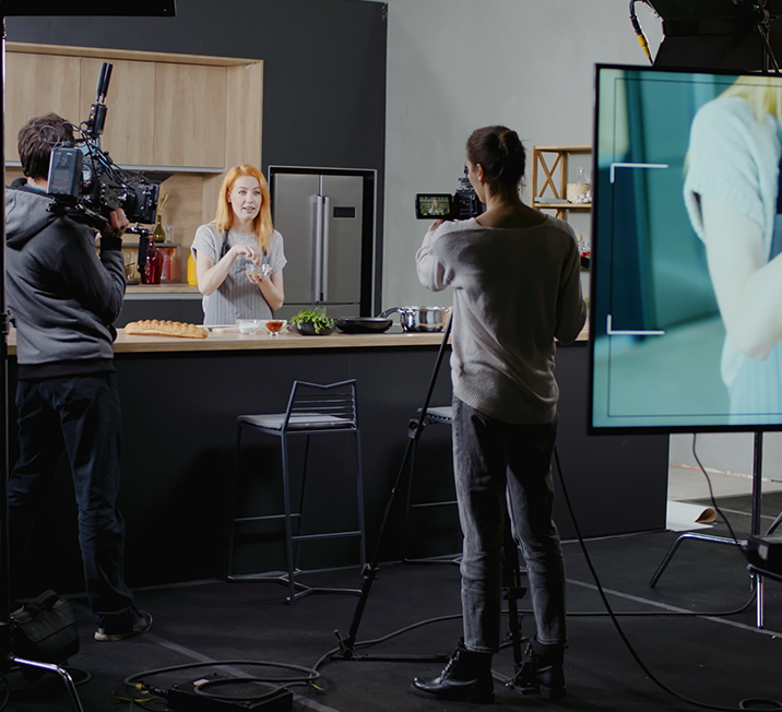 woman being video taped for cooking show