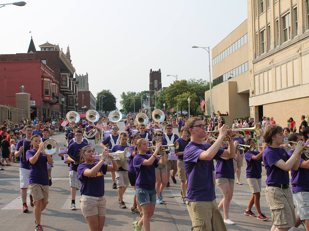 marching band walking streets of downtown muscatine