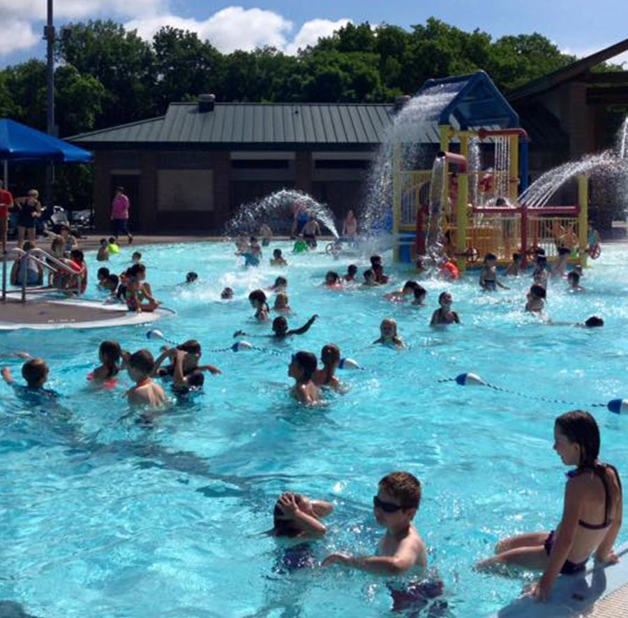 kids playing in large pool