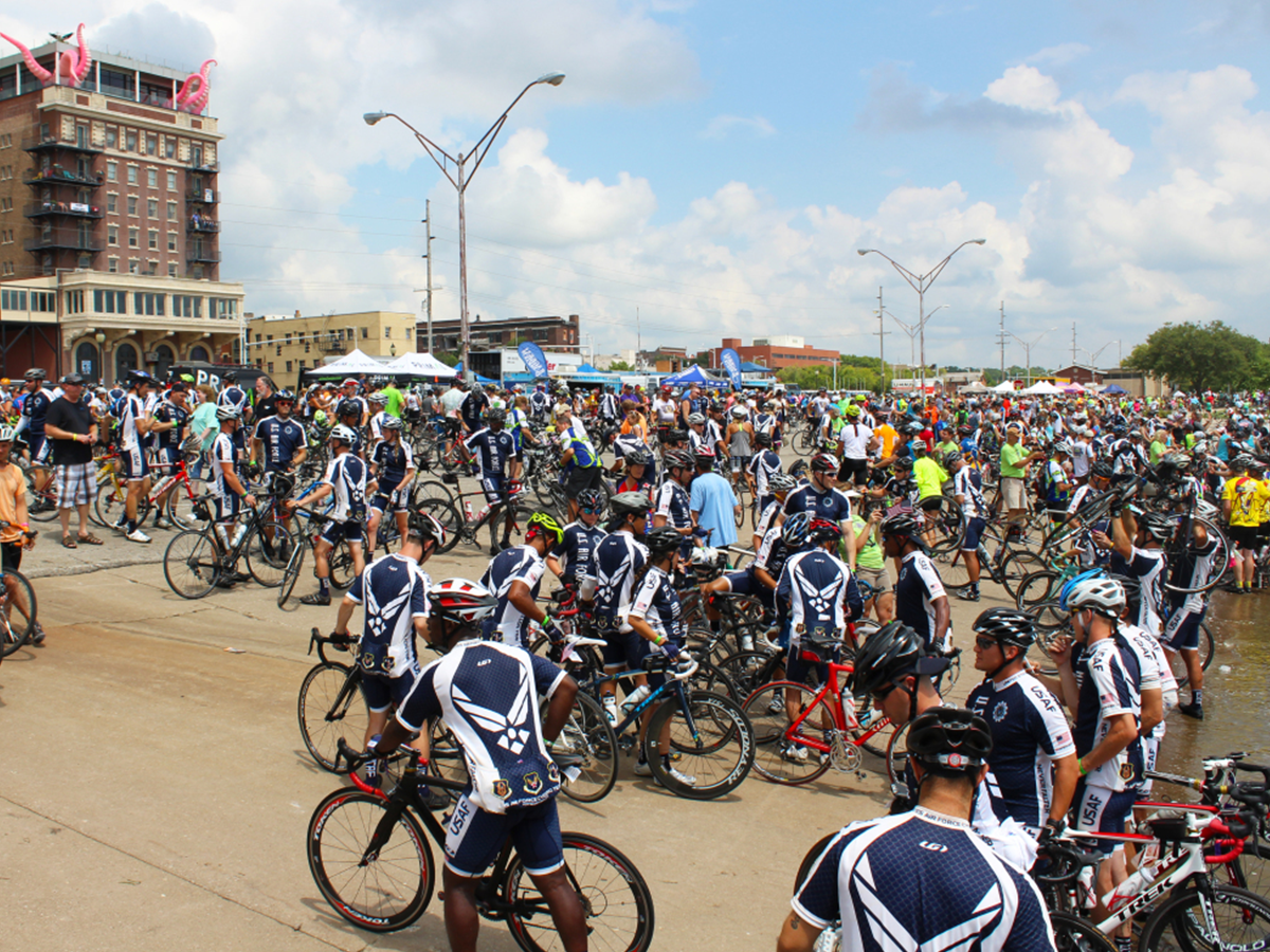 hundreds of bikers gathered at muscatine river