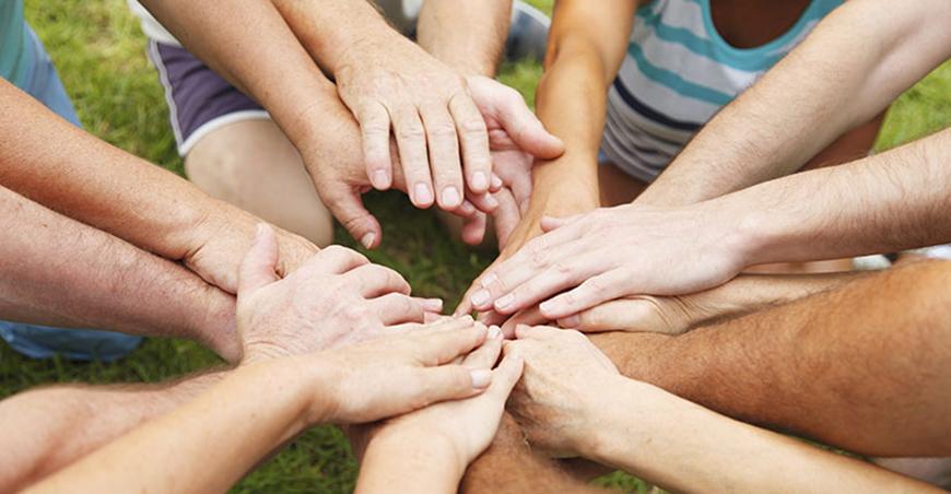 hands piled together