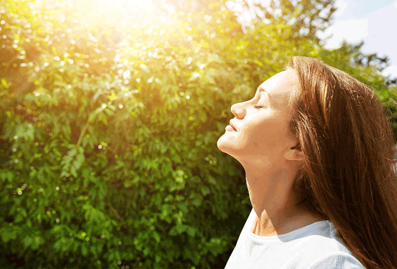 Girl looking into the SUN