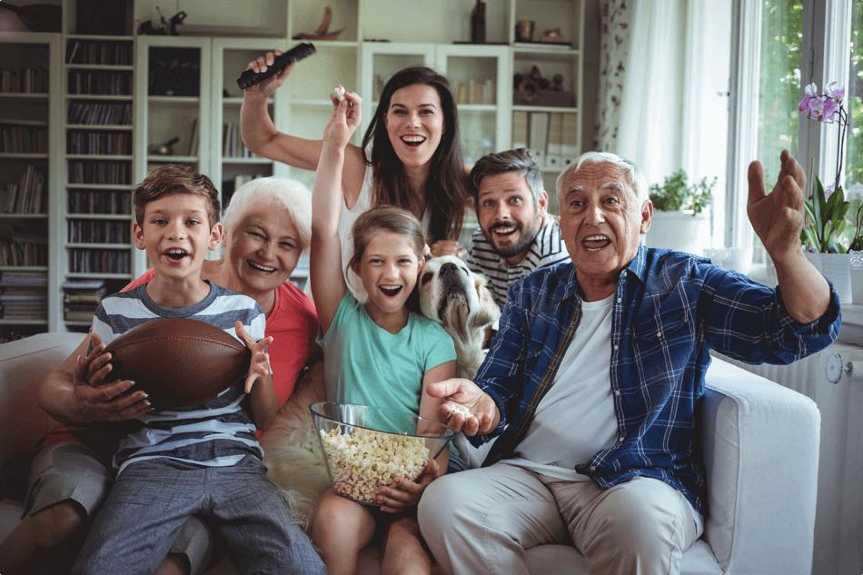 family waving at tv