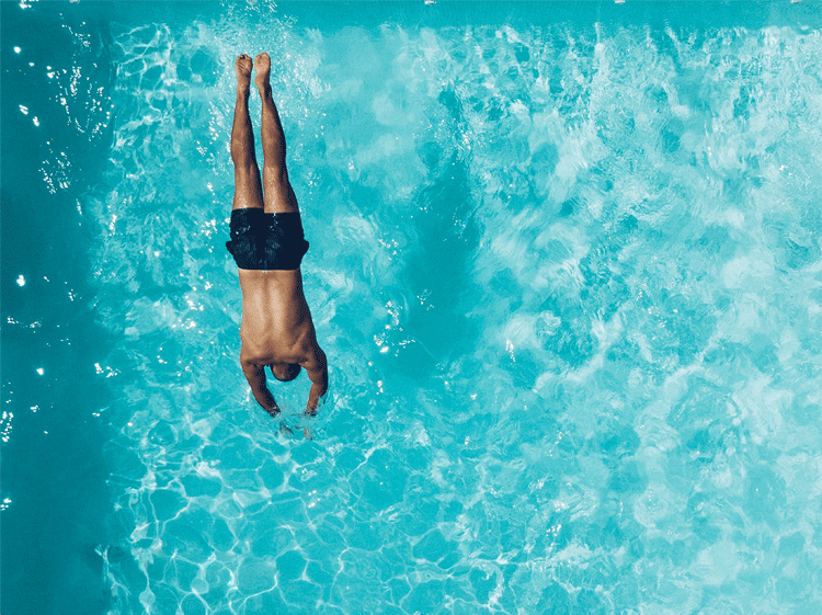 person diving into water